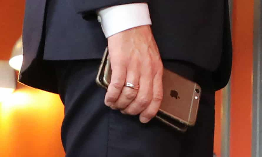 France's president, Emmanuel Macron, holds his mobile phones during the European social summit in Gothenburg, Sweden, November 2017.