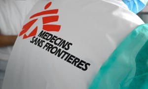 An MSF worker wears clothing with the name of the organisation on the back
