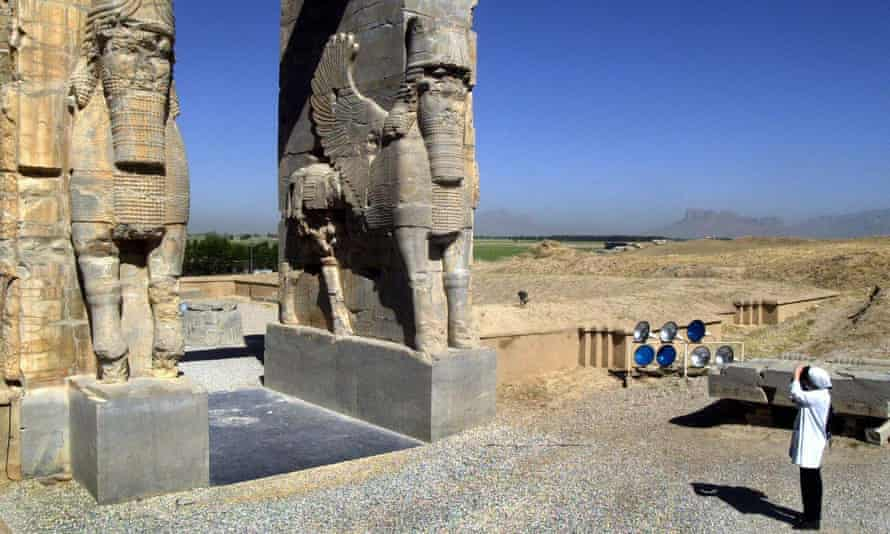 A tourist at The Gate of All Nations in Persepolis, Iran
