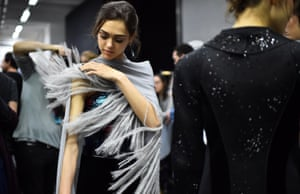 Models get ready backstage before the Giorgio Armani women Fall / Winter 2015/16 show