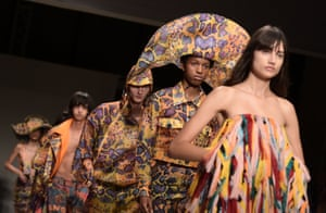 Models present spring/summer designs by the Chinese designer Angel Chen in Milan, Italy