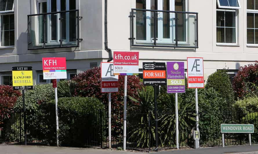 Estate agent signs surround a block of flats in Kent, April 2020.
