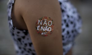 A woman sports a sticker that reads 'No is no!' during an event to combat violence against women in Rio de Janeiro, Brazil.