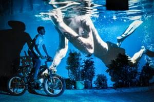 Edoardo Delille and Giulia Piermartiri projected tourist diving photos onto local scenes