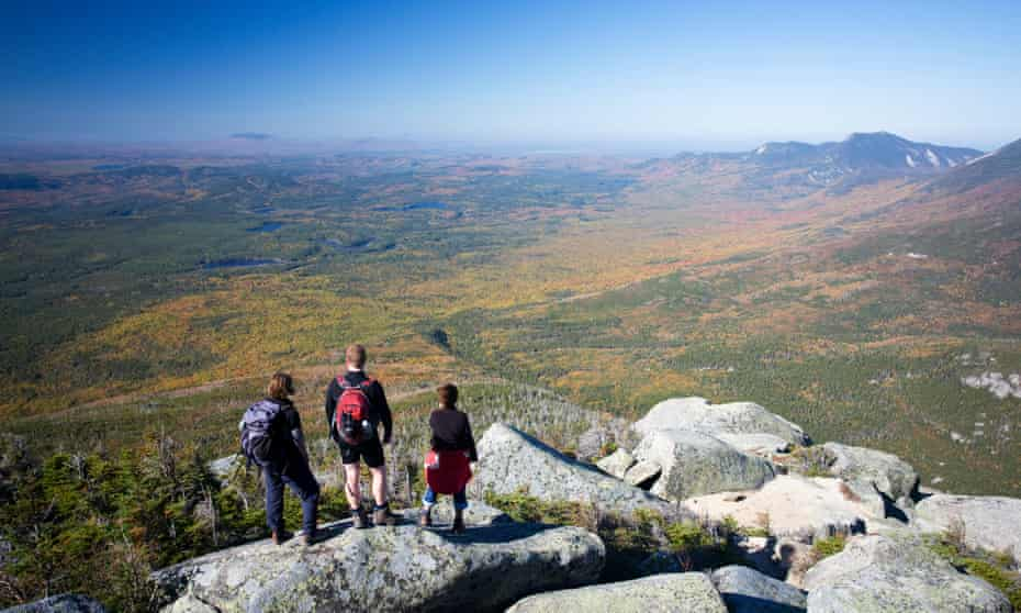 Hikers looking out over Baxter State/Province Park from Mt Katahdin.