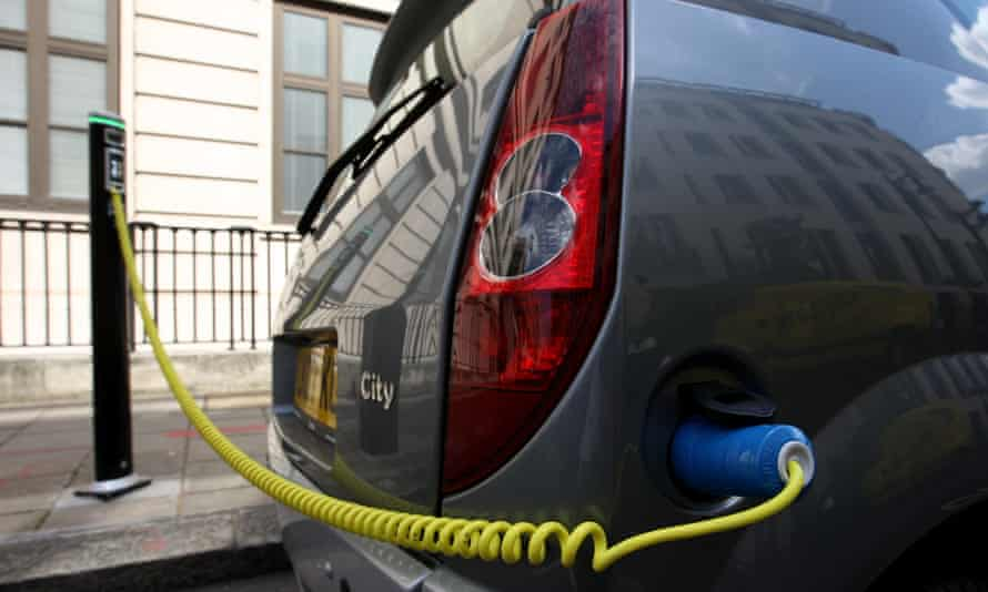 An electric car being recharged as eight towns and cities have been given a share of a £40m fund to promote the uptake of plug-in electric cars