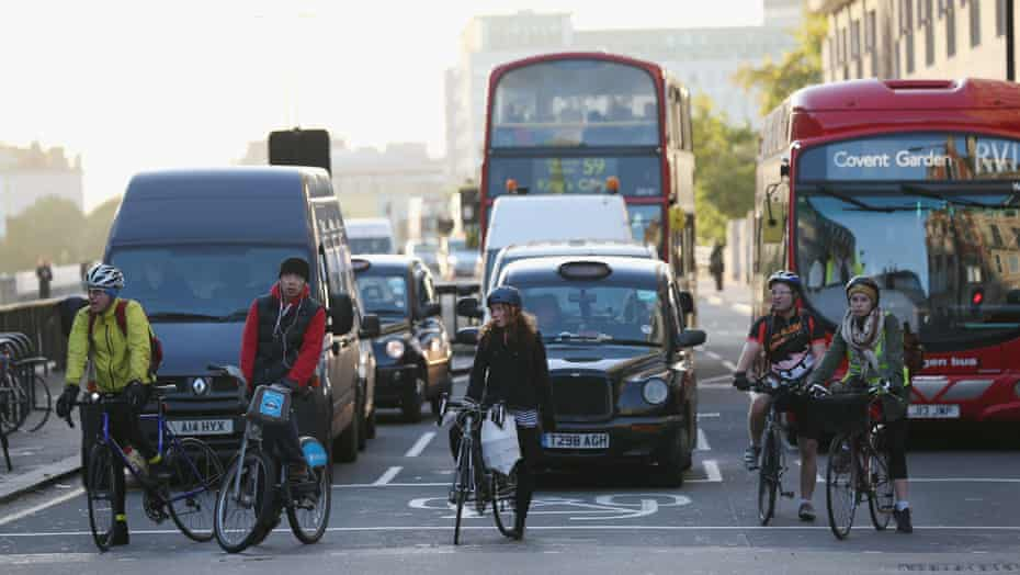 Cyclists negotiate rush hour traffic in central London.