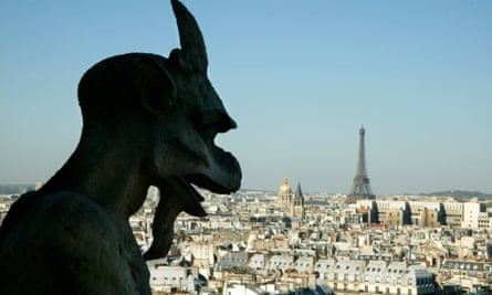 Gargoyles look down from Notre Dame Cathedral in Paris, France.