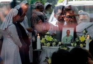 Mourners pray in front of Brazilian Rodrigo Gularte's coffin