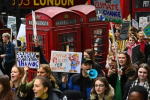 UK students take part in a strike for the climate crisis in Piccadilly Circus, London