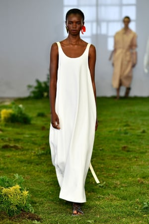 One of the secrets of easy summer dressing is a billowing maxi-dress like this white one from Lee Mathews
