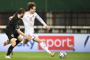 Andreas Skov Olsen (right) prepares to fire home Denmark's fourth goal.