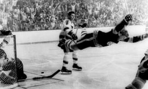 Boston's Bobby Orr flies through the air after scoring the winning goal against the St Louis Blues in the 1970 Stanley Cup