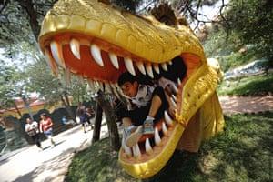 Children play in model dinosaur