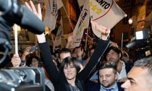 Chiara Appendino celebrates her victory with supporters in Turin.