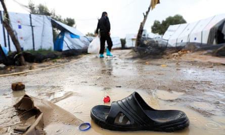 An abandoned flip flop in the mud at Moria camp