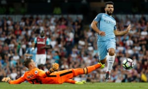 Manchester City's Sergio Aguero skips over the challenge of West Ham United's Adrian but the flag had gone up for offside. It was a tight decision.