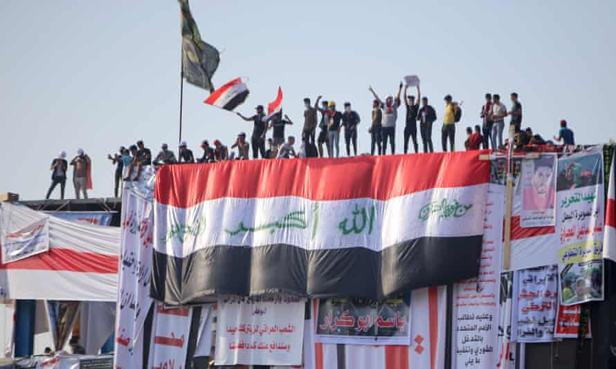 Anti-government protests take to the roof of a building in Baghdad, 2 November 2019.