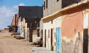 Homes on a sandy street in Tarfaya