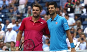 Stan Wawrinka and Novak Djokovic pose for photos at the net before the match begins.