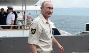 President Putin seems in a jovial mood before boarding the submersible