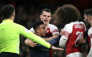 Jesse Lingard clashes with Arsenal players.