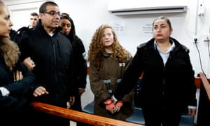 Ahed Tamimi stands for a hearing in the military court at Ofer military prison in the West Bank.
