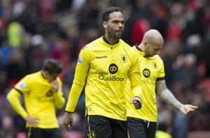 Captain Joleon Lescott walks from the pitch after relegation.