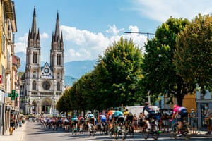 The peloton in action near the Eglise Saint Bruno de Voiron during stage 16 from La Tour-du-Pin to Villard-de-Lans.