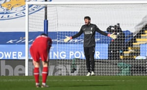 Liverpool's Alisson reacts after Leicester City's Harvey Barnes
