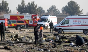Officials inspect the wreckage of the Kyiv-bound Ukraine International Airlines jet that crashed near Tehran, killing everyone onboard