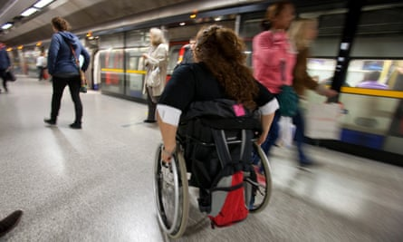 A person in a wheelchair prepares to board the London Underground