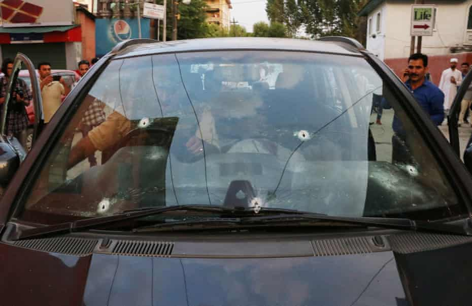 Bullet marks seen on the car of Shujaat Bukhari after he was attacked in Srinagar, India.