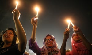 Women take part in a candle light vigil to mark International Women's Day in Dhaka, Bangladesh.