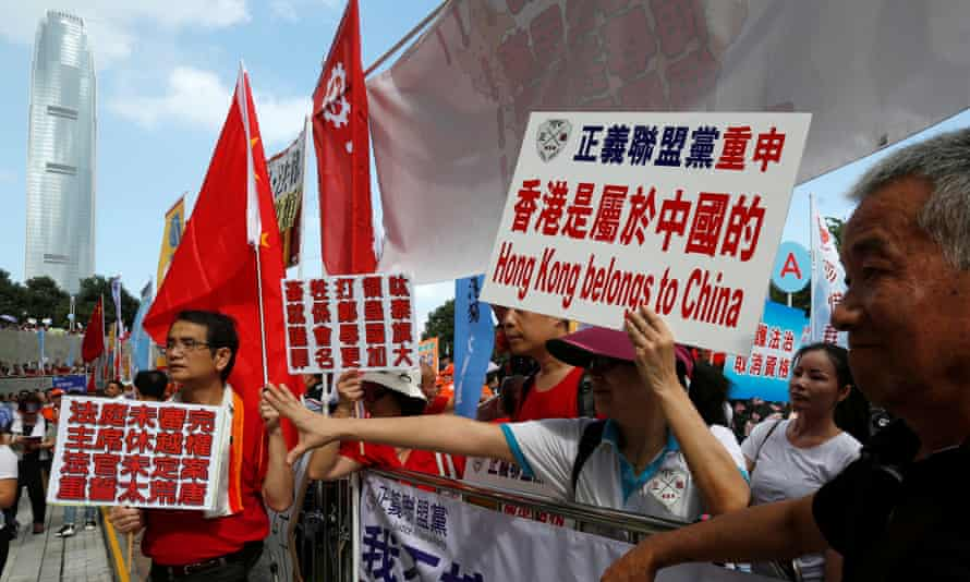 Pro-China protesters demonstrate outside the legislative council in Hong Kong.