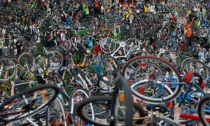 Cyclists in Budapest hold up their bikes