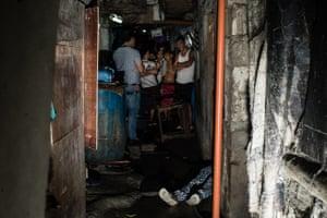 A body lies in a Manila slum.