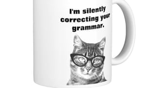 Mug with a picture of a cat on it correcting your grammar
