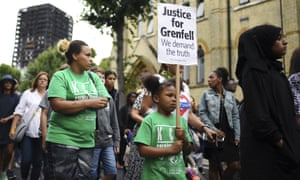 Marchers with placard reading: 'Justice for Grenfell: We demand the truth'