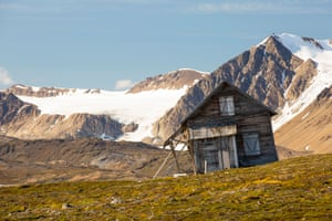A house sliding down a thawing slope of permafrost in Spitsbergen, Norway