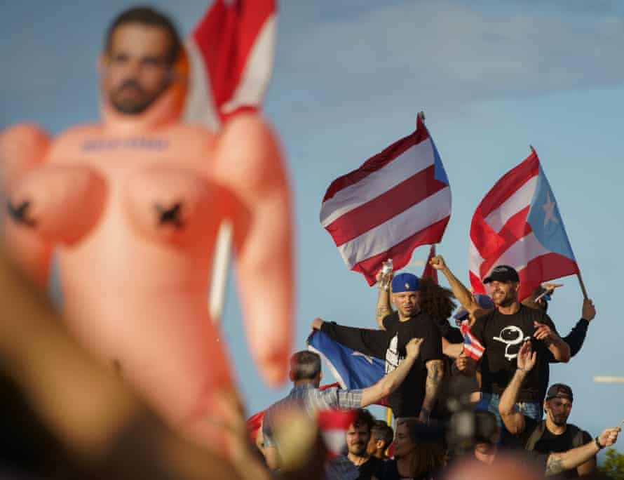 Puerto Rican superstars Residente and Ricky Martin lead the crowds in a 100,000-strong protest against the governor. Martin was a target of Ricardo Rosselló's homophobic messages.