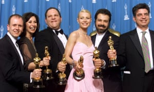 The producers of the Miramax film Shakespeare in Love hold their Oscars with Gwyneth Paltrow, one of the latest women to come forward with accusations against Harvey Weinstein (third from left)