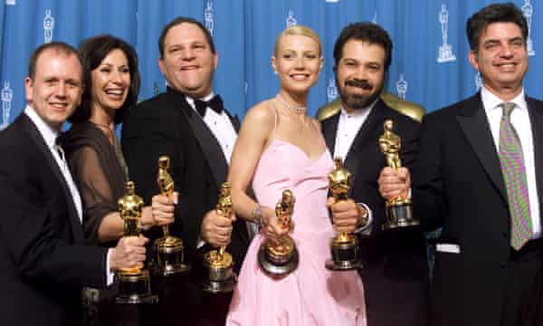 """The producers of the Miramax film """"Shakespeare in Love"""" hold their Oscars"""