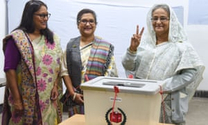 Bangladeshi prime minister Sheikh Hasina casts her vote in Dhaka with her daughter Saima Wazed Hossain (left) and her sister Sheikh Rehana.