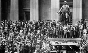 A crowd of speculators gather in front of the New York stock exchange on Black Thursday, 24 October 1929.