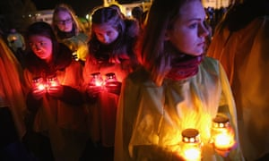 Young people prepare to lay candles as part of a ceremony to commemorate the 30th anniversary of the Chernobyl disaster.