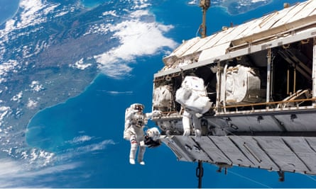 Astronauts spacewalking outside the ISS.
