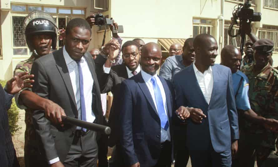 Kenyan doctors' union leaders Ouma Oluga, left, Samuel Oroko, centre, and Allan Ochanji, right, are led away after a court hearing in Nairobi.