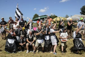 Supporters, wearing Brittany regional costumes made with bin bags, cheer along the route between Rennes and Mur-de-Bretagne, during stage 8