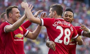 Morgan Schneiderlin is congratulated by Memphis Depay and Phil Jones after scoring the game's only goal in the clash between Manchester United and Club America.
